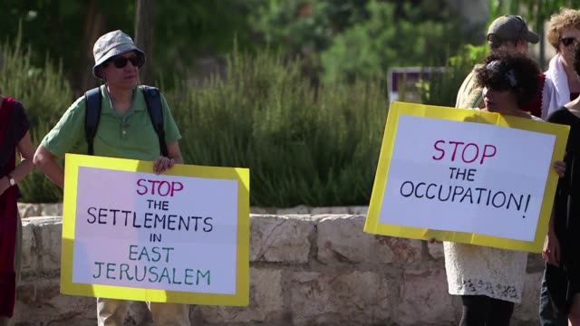 israeli palestinian and foreign activists demonstrated on friday in the predominantly palestinian neighbourhood of sheikh jarrah in east jerusalem to... - east jerusalem stock videos and b-roll footage