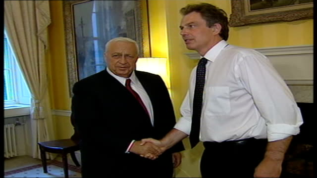 israeli pm ariel sharon meets british pm tony blair / protests pool london downing street blair sharon walking towards in corridor blair sharon stand... - ariel sharon stock videos and b-roll footage