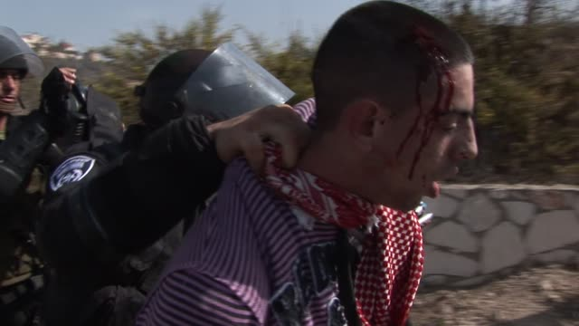 stockvideo's en b-roll-footage met israeli police and stonethrowing arabs clashed in northern israel on wednesday as a group of extreme rightwing israelis tried to march through the... - meer dan 50 seconden