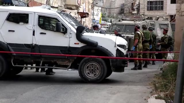 Israeli police arrive at the scene where a Palestinian man attacked an Israeli soldier near a holy site in the southern West Bank city of Hebron...