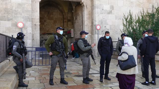 israeli police check identity and prevent passage of non-residents of the old city at a checkpoint in damascus gate, amid new lock-down imposed due a... - israeli military stock videos & royalty-free footage