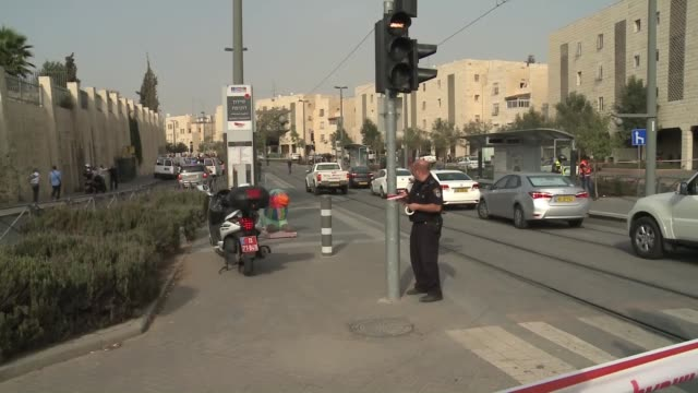 israeli police inspect the area after israeli police shot dead a palestinian man who allegedly stabbed two israelis in the pisgat ziev residential... - east jerusalem stock videos & royalty-free footage
