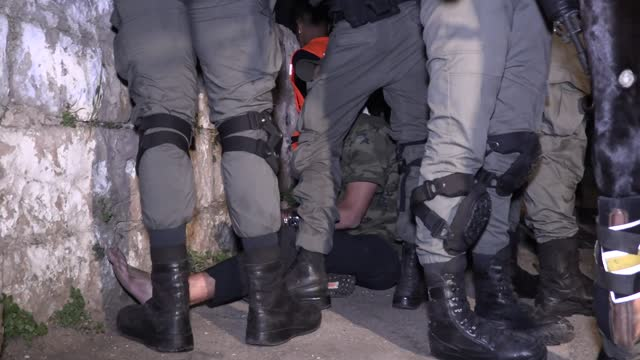 israeli police late wednesday, may 5, intervened against a demonstration in occupied east jerusalem that was held to support the families who were... - jerusalem stock videos & royalty-free footage