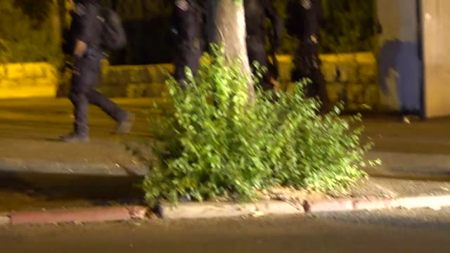 israeli police on wednesday, may 12, intervened against the palestinians who were doing a peaceful sit-in protest in the sheikh jarrah neighborhood... - ガザ市点の映像素材/bロール