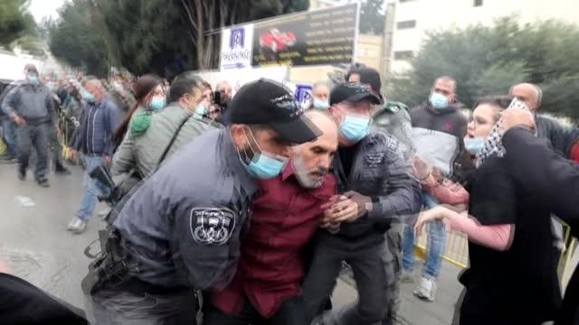 israeli police scuffle with arab israelis demonstrating in the northern city of nazareth against a plan by the prime minister benjamin netanyahu to... - politician stock videos & royalty-free footage