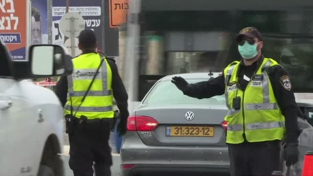 israeli police stop vehicles at a checkpoint in the mostly ultraorthodox jewish city of bnei brak near tel aviv considered as the centre of israel's... - israel stock videos & royalty-free footage