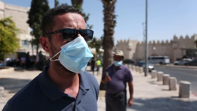 israeli police stopped palestinians coming from outside the old city of jerusalem from entering alaqsa mosque for friday prayers under the pretext of... - israel palestine conflict stock videos & royalty-free footage
