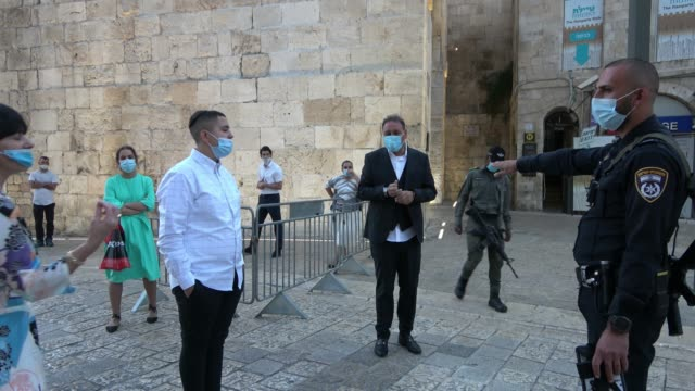 israeli policemen prevent passage of religious jews at a checkpoint in jaffa gate as israel enters a new coronavirus lock-down on september 18, 2020... - jaffa stock videos & royalty-free footage