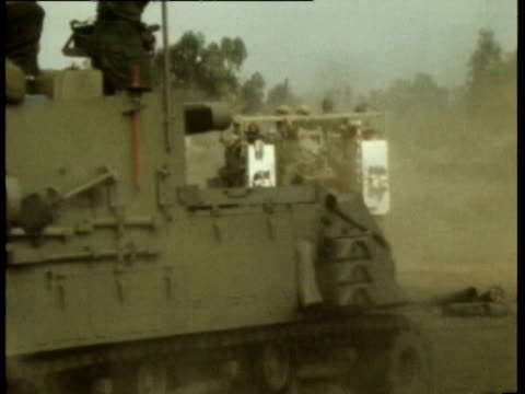 vídeos de stock, filmes e b-roll de israeli positions in the golan heights along the israel/syria border / m3 half track personnel carrier driving along / israeli troops on self... - 1973