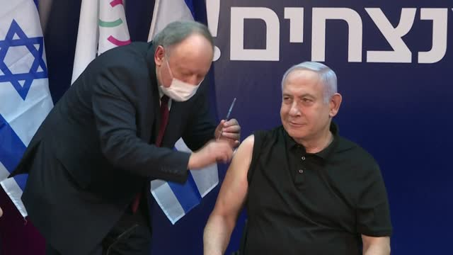 israeli prime minister benjamin netanyahu is injected with the pfizer-biontech covid-19 vaccine live on tv, kicking off a national rollout over the... - benjamin netanyahu stock videos & royalty-free footage
