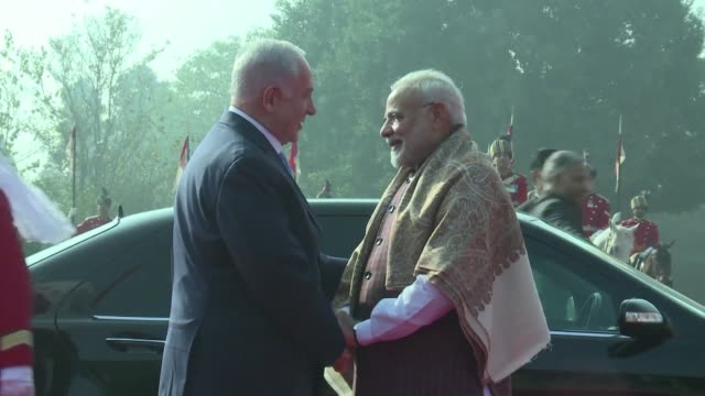 Israeli Prime Minister Benjamin Netanyahu reviews the Indian guard of honour on his second day in the Indian capital