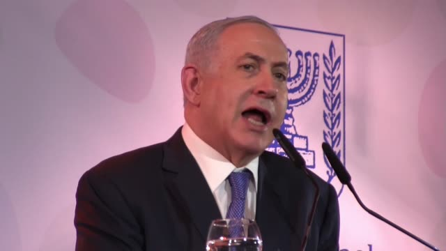 Israeli Prime Minister Benjamin Netanyahu speaking to reporters at the Government Press Office's annual New Year's event in Jerusalem on January 14...