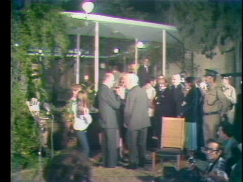 israeli prime minister menachem begin leaves a press conference after talking about sharing the 1978 nobel peace prize with egypt's president anwar... - 1978 stock videos & royalty-free footage