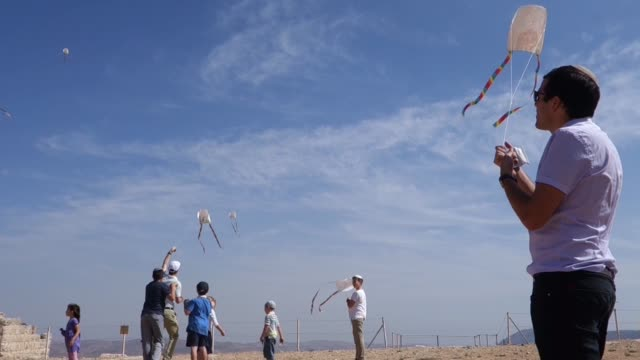 israeli religious children flying kites on mount gerizim one of the highest peaks in the west bank near the city of nablus in the west bank israel... - kid with kite stock videos & royalty-free footage