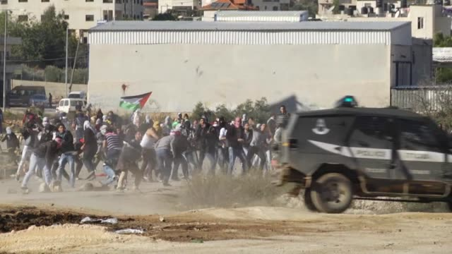 israeli security force use tear gas against palestinian youths who protest the israeli authorities on the issue of al-aqsa mosque compound in... - israeli military stock videos & royalty-free footage