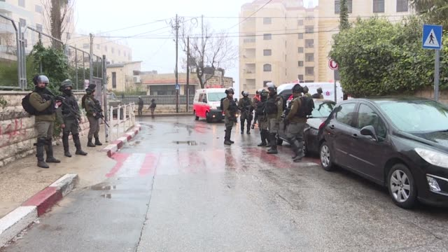 israeli security forces arrest a palestinian and seize a car during raids carried out in the city of ramallah as dozens of young palestinians threw... - ramallah stock videos and b-roll footage