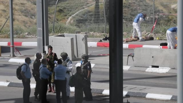 israeli security forces at the scene where a palestinian man carried out an attack against israeli forces and was subsequently shot dead, according... - customs stock videos & royalty-free footage