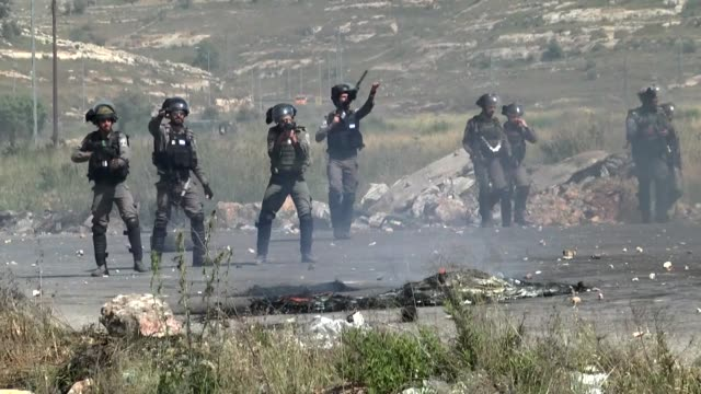 israeli security forces clash with palestinian demonstrators following a protest in support of hungerstriking palestinian prisoners in israeli jails... - ramallah stock videos and b-roll footage