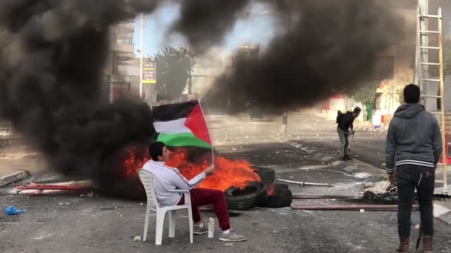 israeli security forces clash with palestinian demonstrators who stage a protest against us president donald trump's recognition of jerusalem as... - palestinian stock videos & royalty-free footage