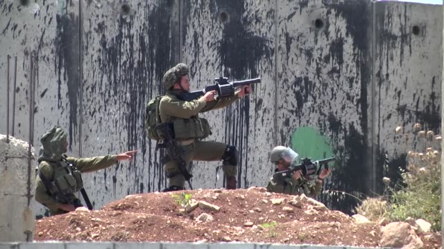 israeli security forces clash with palestinian protesters who stage a demonstration in solidarity with israeliheld palestinian prisoners who are on... - prisoner icon stock videos & royalty-free footage