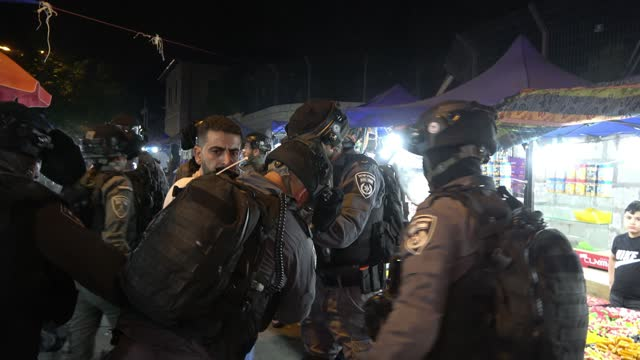 israeli security forces detain a palestinian protester during clashes with palestinians outside damascus gate on may 09, 2021 in east jerusalem,... - israel stock videos & royalty-free footage