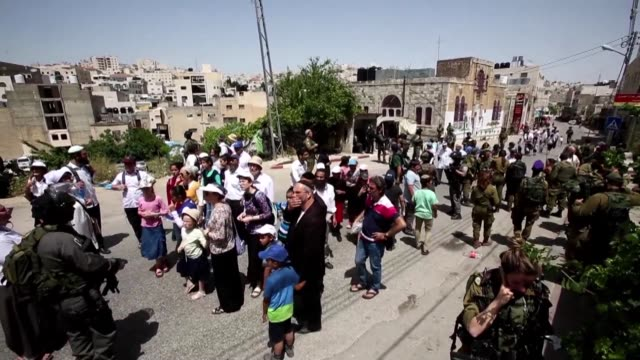israeli security forces escorted a group of jewish settlers tuesday through a palestinian neighbourhood in the divided west bank city of hebron as... - passover stock videos and b-roll footage