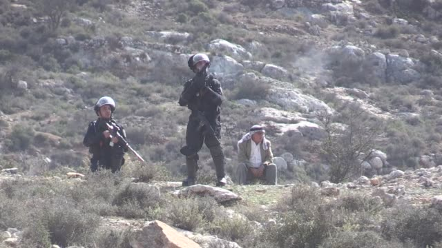 israeli security forces fires tear gas towards palestinian protesters during a demonstration against israeli land seizures for jewish settlements in... - ramallah stock videos and b-roll footage