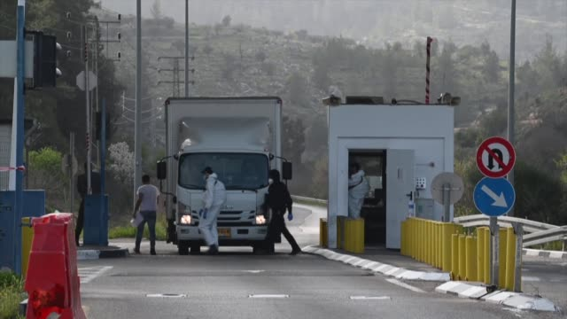 israeli security forces in protective gear check vehicles at the walajah checkpoint in jerusalem on a road leading to the west bank city of bethlehem - west bank stock videos & royalty-free footage