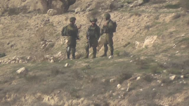 Israeli security forces intervene in Palestinians near Hawara checkpoint south of the West Bank city of Nablus during clashes following a...