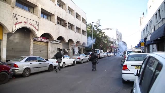 israeli security forces intervene palestinian demonstrators at saladin street in east jerusalem on december 16 as demonstrations continue to flare in... - east jerusalem stock videos and b-roll footage