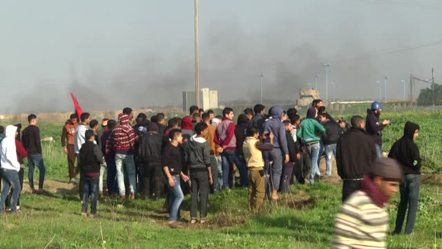 israeli security forces palestinian protesters during demonstrations continuing over us president donald trump's declaration of jerusalem as israel's... - 2018 gaza border protests stock videos & royalty-free footage