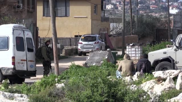 vídeos de stock e filmes b-roll de israeli security forces search cars and homes at bruqin in salfit city of the occupied west bank on march 17 following an attack that killed an... - southwest usa