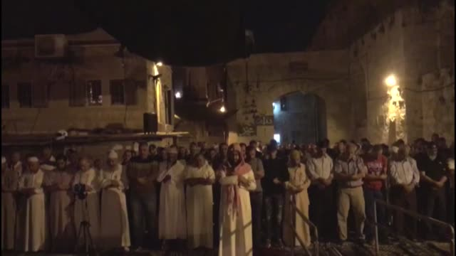 israeli security forces stand by as palestinian muslim worshippers pray outside lions' gate, a main entrance to the al-aqsa mosque compound in... - 2017 stock videos & royalty-free footage