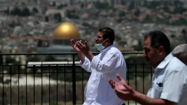 israeli security forces stand guard as muslim worshippers perform the last friday prayer of the holy month of ramadan, outside the al-aqsa mosque... - human settlement stock videos & royalty-free footage