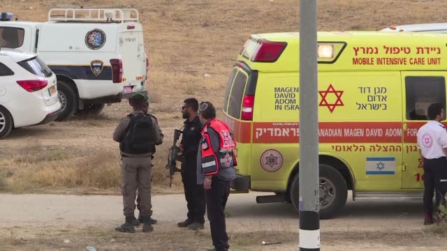 israeli security forces stand guard in kfar adumim next to the ambulance carrying a palestinian woman who tried to stab israeli officers with... - shears stock videos & royalty-free footage