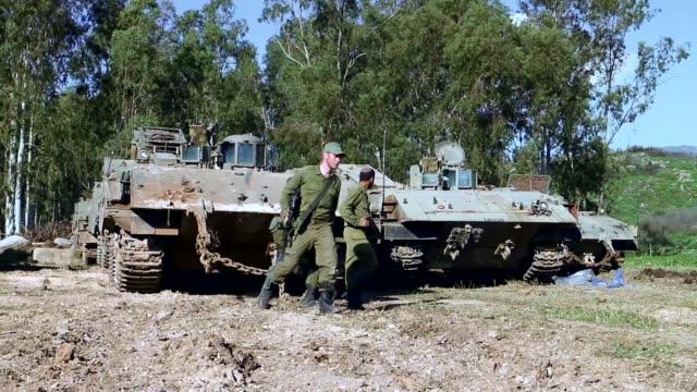 israeli security forces take security measures against possible attacks near hagoshrim dwelling unit in kiryat shmona israel on january 29 2015... - hezbollah stock videos & royalty-free footage