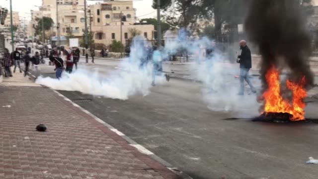 Israeli security forces use tear gas to disperse protestors during a protest against US President Donald Trump's announcement to recognize Jerusalem...