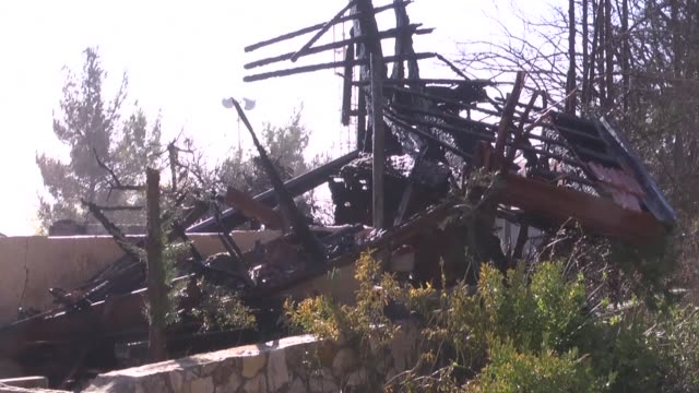 vídeos de stock, filmes e b-roll de israeli settlers assessed the damaged caused to their homes in the halamish settlement also known as neveh tzuf northwest of ramallah in the occupied... - ramallah