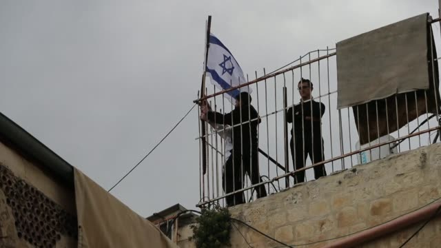 israeli settlers place the israeli flag on the roof of the abu asab family house after the palestinian family was evicted by police from the house in... - old town stock videos & royalty-free footage