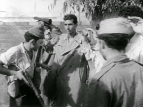 israeli soldier checking pockets of captured egyptian soldiers with arms raised / suez crisis - israeli military stock videos and b-roll footage