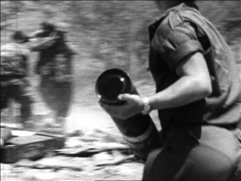 israeli soldier running while carrying cannister in six day war / newsreel - sechstagekrieg stock-videos und b-roll-filmmaterial