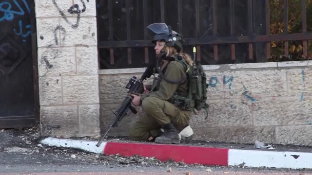 israeli soldiers clash with palestinians who protest expropriation of palestinian land by israel and the wall of shame the separation barrier between... - ramallah stock videos and b-roll footage