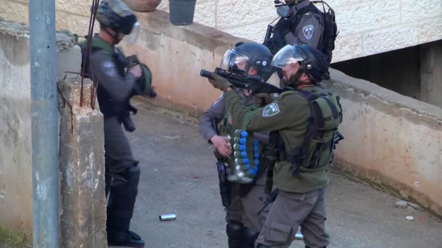 israeli soldiers clash with palestinians who resist the demolition of a palestinian house by israel in the bedres village of ramallah west bank on... - ramallah stock videos and b-roll footage