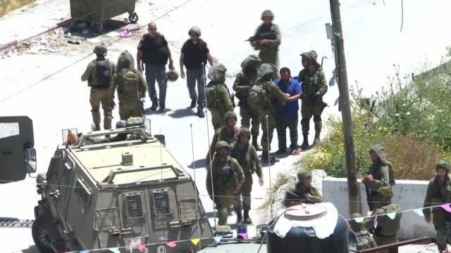 israeli soldiers detain palestinians in the village of yabad near the west bank city of jenin during a search operation after a palestinian... - israel stock videos & royalty-free footage