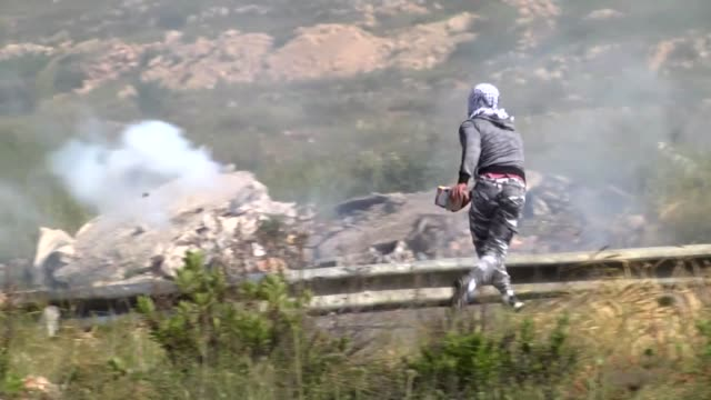 israeli soldiers intervene to palestinians who stage a demonstration in support of palestinian prisoners in israeli jails near the jewish settlement... - palestine liberation organisation stock videos & royalty-free footage