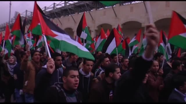 israeli soldiers intervenes to palestinian protesters demanding to get the bodies of people who lost their lives during the demonstrations in hebron... - palestinian flag stock videos & royalty-free footage