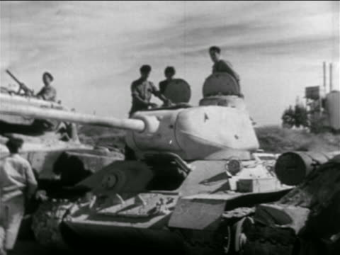 israeli soldiers on parked tank with moving gun / suez crisis / newsreel - 1956 stock-videos und b-roll-filmmaterial