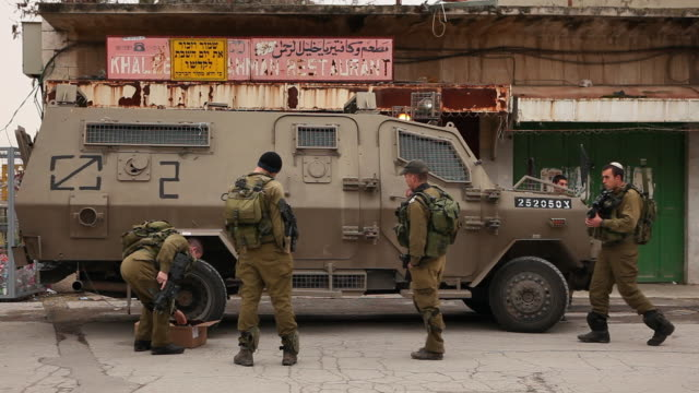 israeli soldiers prepare their vehicle to move out. - palestinian territories stock videos and b-roll footage