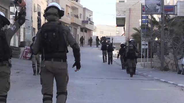 israeli soldiers raided a village in the south of the occupied west bank on tuesday, feb. 9, and detained one palestinian teenager. another teenager... - palestinian territories stock videos & royalty-free footage