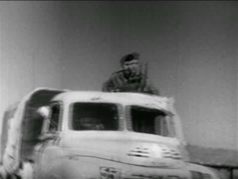 israeli soldiers riding on trucks past camera outdoors / israel / suez crisis / newsreel - 1956 stock videos & royalty-free footage